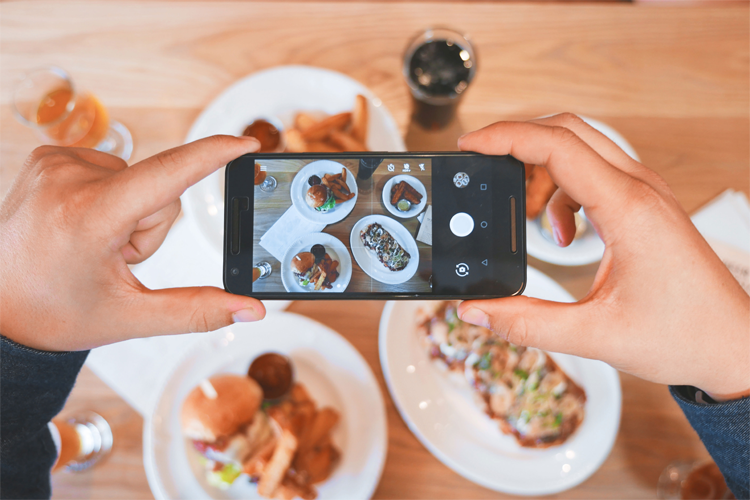Photo of smartphone taking picture of food
